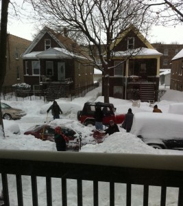 View of Chicago street after huge snowfall, good samaritans helping jeep stuck in snow