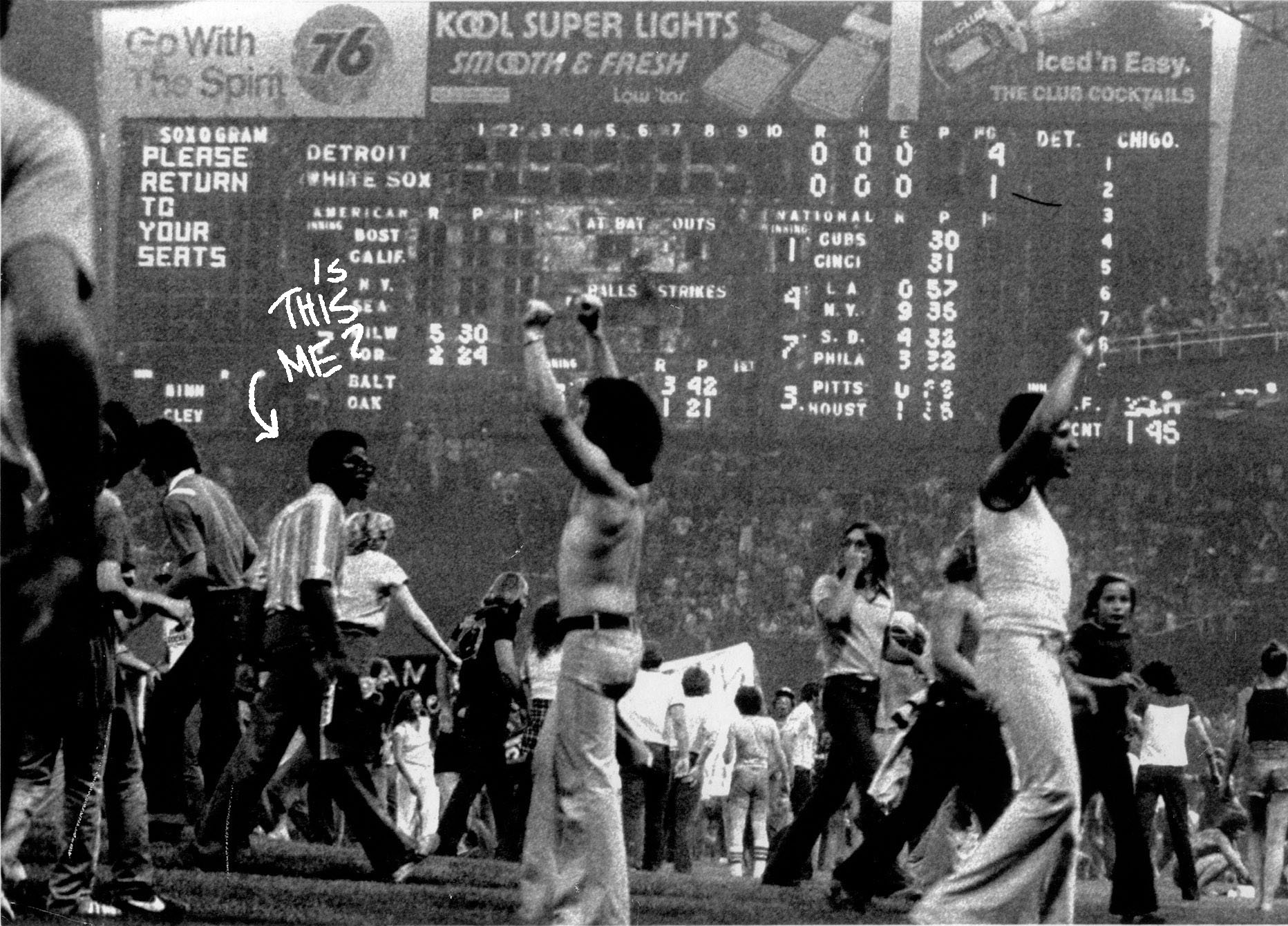 7/13/1979 -- The White Sox scoreboard message goes unheeded as thousands of spectators engulf the field during an anti-disco demonstration that caused the second game of a double-header to be called off. Detroit won the opener 4-1. UPI photo by Hank DeGeorge.(demolition,Comiskey park,baseball pro,Chicago)